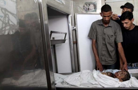 The body of six-year-old Palestinian, Ali al-Shwaf is seen at the Nasser hospital morgue in Khan Yunis, in the southern Gaza Strip on June 23, 2012 after he was killed during Israeli air strikes in Gaza. Two others were wounded in the shelling, but the Israeli military denied it was responsible. AFP PHOTO/ SAID KHATIB