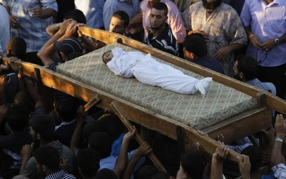 "Palestinian mourners carry the body of  6-year-old Ali al-Shwaf during his funeral in Khan Younis, southern Gaza Strip, Saturday, June 23, 2012. Gaza's militant Hamas rulers threatened to escalate fighting with Israel on Saturday after airstrikes killed several gunmen in the coastal territory, and Palestinian rocket attacks on Israel wounded one person and damaged an elementary school in the country's south. Meanwhile, Gaza health official Ashraf Al Kedra said a boy was killed in a playground during an airstrike Saturday morning in Khan Younis. The Israeli military said it had not attacked that area. Military spokeswoman Lt. Col. Avital Leibovich later called the allegation a ""false rumor"" and said that according to intelligence information, the boy was killed by ""ordinance belonging to one of the terror groups."" Palestinian rockets often misfire and explode inside Gaza. (AP Photo/Hatem Moussa)"