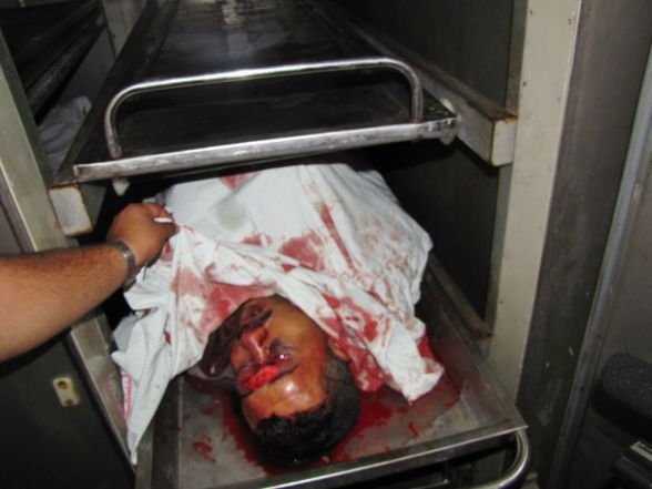 Shaheed Osama Mahmoud Ali, 42 years old in the morgue. Photo by Rosa Schiano Gaza June 23, 2012