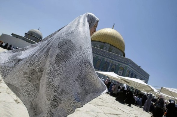 Palestinian worshipers gather for prayer outside the Dome of the Rock at the al-Aqsa mosque compound in Jerusalem during the Muslim holy month of Ramadan, Friday, Aug. 10, 2012. Ramadan is the ninth month of the Muslim year which lasts 30 days, and is devoted to dawn-to-dusk fasting, prayers and good deeds. (AP Photo/Nasser Shiyoukhi)