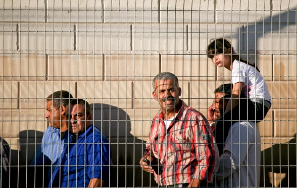 Aug 10, 2012, Fourth firday of Ramadan at Qalandiya. Palestinians on their way to the mosque to attend prayers. Not only a nation but a religion under occupation too. Photo by WAFA