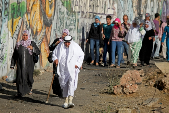 Aug 10, 2012, Fourth friday of Ramadan at Qalandiya. Palestinians on their way to the mosque to attend prayers. Not only a nation but a religion under occupation too. Photo by WAFA
