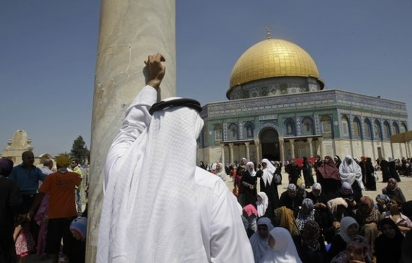 Palestinians gather outside the Dome of the Rock at the al-Aqsa mosque compound in Jerusalem during the Muslim holy month of Ramadan, Friday, Aug 03, 2012. Ramadan is the ninth month of the Muslim year which lasts 30 days, during which strict fasting is observed from sunrise to sunset. (AP Photo/Nasser Shiyoukhi)