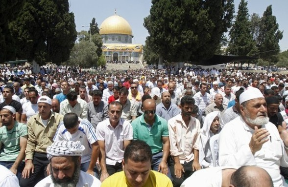 Palestinian Muslims pray outside the Dome of the Rock at the Al-Aqsa mosque compound in Jerusalem during the third Friday prayers of Islam's holy month of Ramadan on August 3, 2012. Muslims fasting in the month of Ramadan must abstain from food, drink and sex from dawn until sunset, when they break the fast with the meal known as Iftar. AFP PHOTO/MUSA AL SHAER