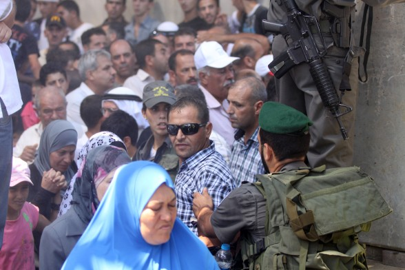 Third Friday of Ramadan. Worshipers at Bethlehem checkpoint. Aug 3, 2012 | Photo by WAFA