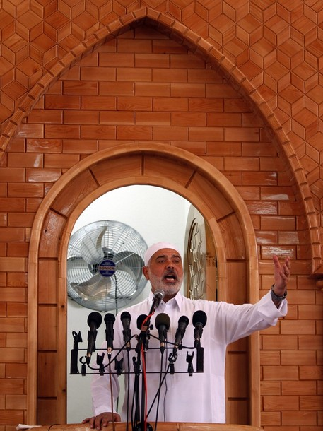 Ismail Haniyeh, Prime Minister of the Gaza Strip government run by the Islamic group, Hamas, gives a speech before Friday prayers  on the first day of the Muslim holy month of Ramadan at  Al Ameen Muhammad mosque, in Jabaliya, northern Gaza Strip , Friday, July 20, 2012. Muslims from Morocco to Afghanistan are steeling themselves for the toughest Ramadan in more than three decades with no food or drink, not even a sip of water, for 14 hours a day during the hottest time of the year. (AP photo/Hatem Moussa)