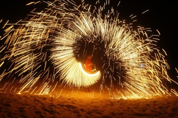 A Palestinian boy plays with fireworks as he celebrates the start of the Muslim holy month of Ramadan in Gaza City, Friday, July 20, 2012. (AP photo/Hatem Moussa)