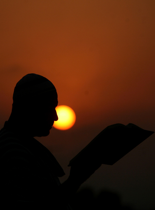 JENIN : A Palestinian man reads the Koran at a mosque in the West Bank city of Jenin on the first day of the Muslim holy fasting month of Ramadan on July 20 2012.