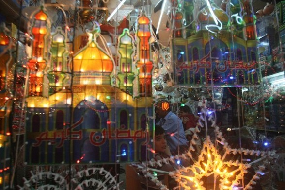 Ramadan decorations are hung outside a shop in the West Bank city of Hebron on July 18, 2012, to welcome the upcoming Muslim holy fasting month of Ramadan. AFP PHOTO / HAZEM BADER