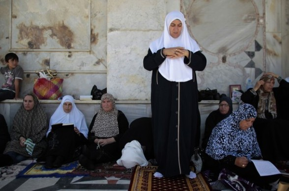 Palestinian women pray outside the Dome of the Rock on the compound known to Muslims as Noble Sanctuary and to Jews as Temple Mount in Jerusalem's Old City on the first Friday of the holy month of Ramadan July 20, 2012. Israeli police said that Palestinian males over the age of 40 would be freely permitted to enter the compound in Jerusalem's Old City on Friday. REUTERS/Ammar Awad