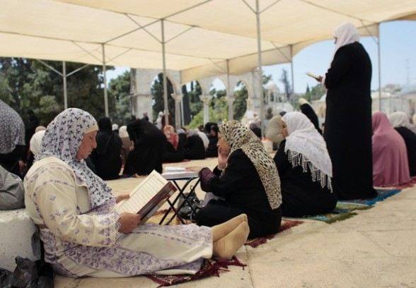 Palestinian women read the Koran in the compound known to Muslims as Noble Sanctuary and to Jews as Temple Mount in Jerusalem's Old City on the first Friday of the holy month of Ramadan July 20, 2012. Israeli police said that Palestinian males over the age of 40 would be freely permitted to enter the compound in Jerusalem's Old City on Friday. REUTERS/Ammar Awad