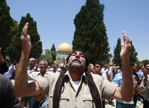 Palestinians attend prayers at the Al Aqsa mosque on the first day of the Muslim holy month of Ramadan in Jerusalem, Friday, July 20, 2012. Muslims from Morocco to Afghanistan are steeling themselves for the toughest Ramadan in more than three decades with no food or drink, not even a sip of water, for 14 hours a day during the hottest time of the year. (AP Photo/Nasser Shiyoukhi)