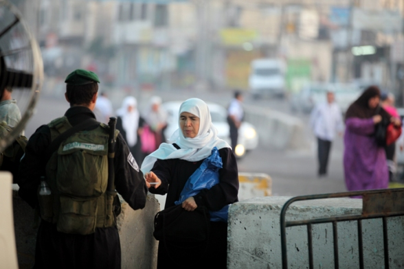 Palestinians wait at Qalandia checkpoint to go to pray at Al-Aqsa for the first Friday of Ramadan July 20, 2012 Photo by WAFA