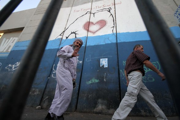Palestinians wait at Bethlehem checkpoint to go to Al-Aqsa to pray for the first Friday of Ramadan  . July 20, 2012 Photo by WAFA