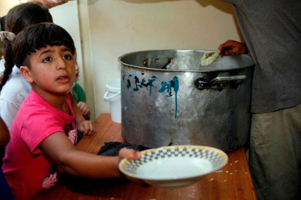 Children receive Ramadan meal in Balata refugee camp, Nablus - July 21, 2012 - Photo by WAFA