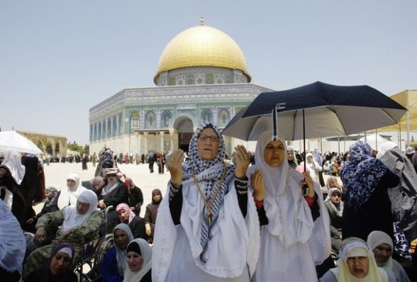 Palestinian worshipers pray outside the Dome of the Rock at the al-Aqsa mosque compound in Jerusalem during the Muslim holy month of Ramadan, Friday, July 27, 2012. Ramadan is the ninth month of the Muslim year which lasts 30 days, during which strict fasting is observed from sunrise to sunset. (AP Photo/Nasser Shiyoukhi)