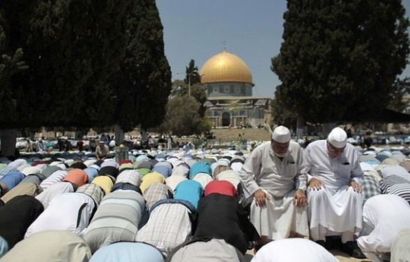 Palestinian men pray in front of the Dome of the Rock on the compound known to Muslims as Noble Sanctuary and to Jews as Temple Mount in Jerusalem's Old City on the second Friday of the holy month of Ramadan July 27, 2012. REUTERS/Ammar Awad
