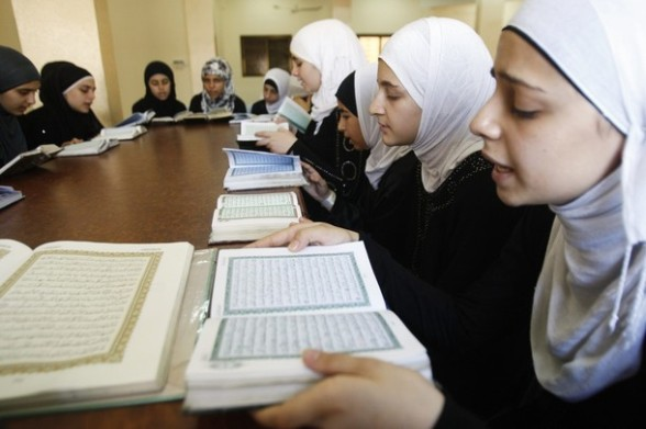 Palestinian girls recite verses from the Koran at a mosque during the holy month of Ramadan in the West Bank city of Nablus July 26, 2012. REUTERS/Abed Omar Qusini