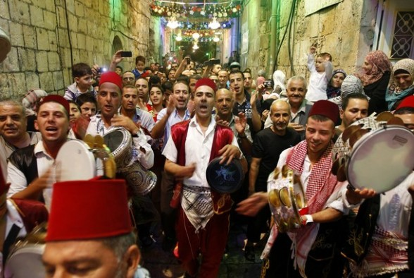 Palestinian musicians perform in Jerusalem's Old City during celebrations to mark the breaking of the fast on the seventh day of the holy month of Ramadan, on July 26, 2012. AFP PHOTO / AHMAD GHARABLI