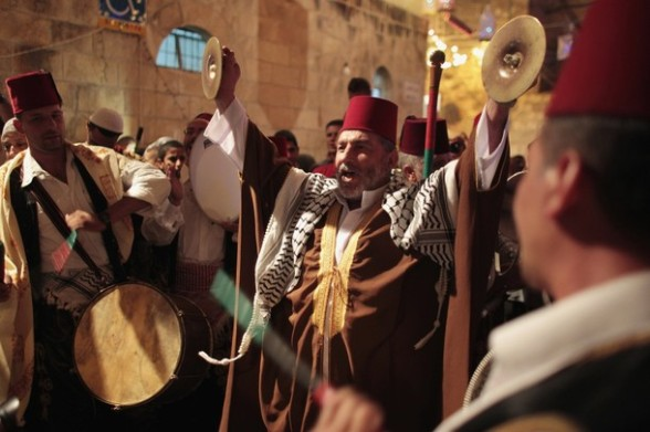 Palestinian musicians perform in Jerusalem's Old City during celebrations to mark the breaking of fast during the holy month of Ramadan July 26, 2012. REUTERS/Ammar Awad