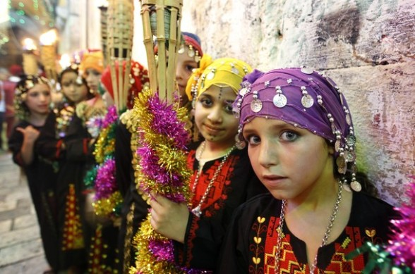 Children perform in Jerusalem's Old City during celebrations to mark the breaking of the fast on the seventh day of the holy month of Ramadan, on July 26, 2012. AFP PHOTO / AHMAD GHARABLI