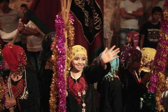 Palestinian girls take part in celebrations to mark the breaking of fast in Jerusalem, during the holy month of Ramadan, July 26, 2012. REUTERS/Ammar Awad