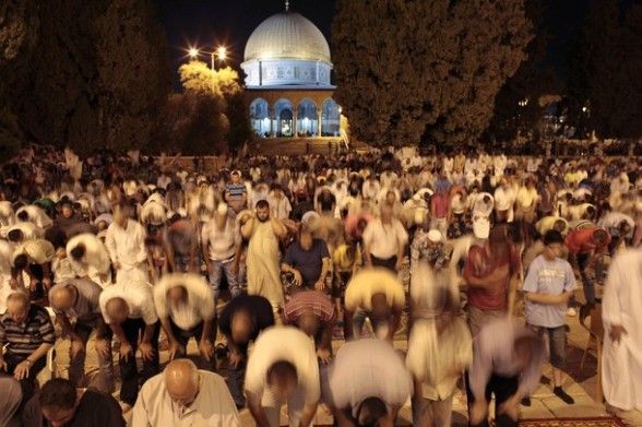 Palestinian men pray in front of the Dome of the Rock, at the compound known to Muslims as Noble Sanctuary and to Jews as The Temple Mount in Jerusalem's Old City during the holy month of Ramadan July 25, 2012. REUTERS/Ammar Awad