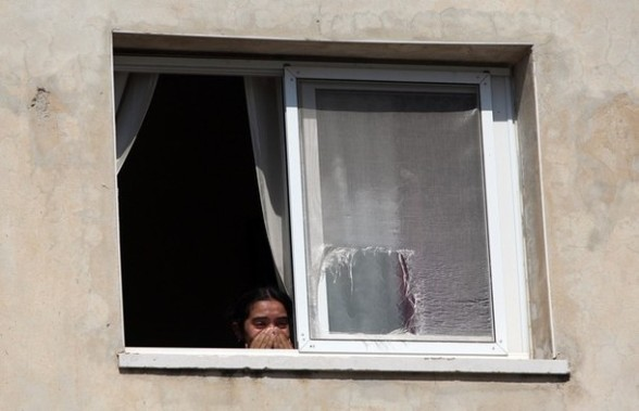 A Palestinian looks out of a window as she weeps during the funeral of 40-year-old Akram Dair in a village close to the West Bank city of Ramallah after he was shot and killed by Israeli soldiers on July 31, 2012, at a checkpoint near East Jerusalem, Palestinian medical and security sources said. AFP PHOTO / ABBAS MOMANI
