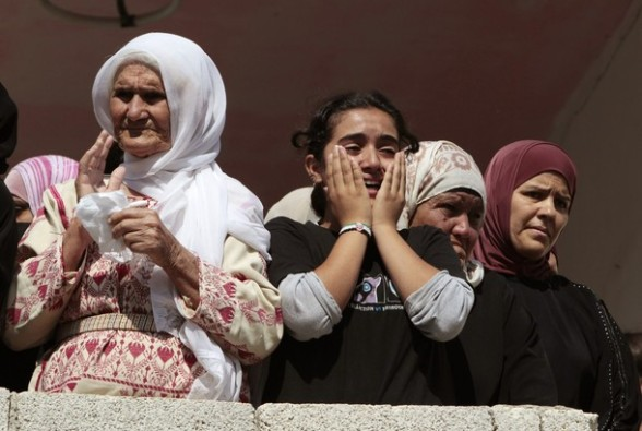 Palestinians mourn during the funeral of Akram Bader in West Bank village of Beitillu, near Ramallah, July 31, 2012. Israeli troops opened fire at a Palestinian car at a checkpoint in the occupied West Bank early on Monday, killing Bader and wounding two others, Palestinian officials said. REUTERS/Ammar Awad