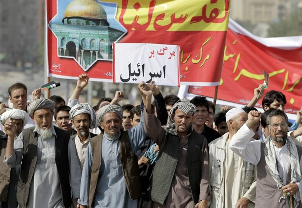 "Afghan men shout anti-Israel slogans and hold a small placard that reads, in Dari, ""death to Israel,"" during a protest in Kabul, Afghanistan, August 17, 2012. Hundreds of demonstrators took to the streets of Kabul on Friday on Al-Quds Day, the last Friday of the Islamic holy month of Ramadan, to show support for the Palestinian people and to demonstrate the importance of the city of Jerusalem to Muslims. Al-Quds is the Arabic name for Jerusalem, where Muslims believe Islam's Prophet Muhammad began his journey to heaven. (AP Photo/Ahmad Jamshid)"