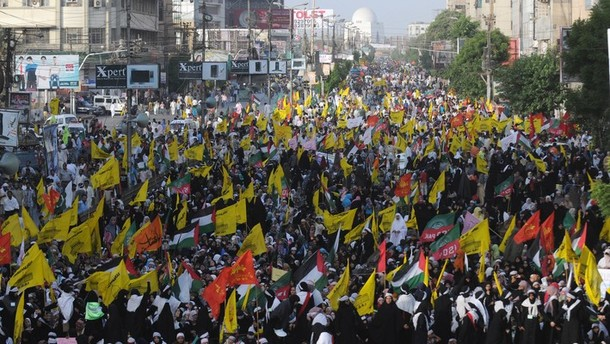 Pakistani Shiite Muslims march during a rally against Israel and the United States to mark the Al-Quds (Jerusalem) day on the last Friday in the month of Ramadan in Karachi on August 17, 2012. Shiite Muslim protesters rallied across the country against the United States and Israel and prayed for the liberation of Palestine. AFP PHOTO / RIZWAN TABASSUM