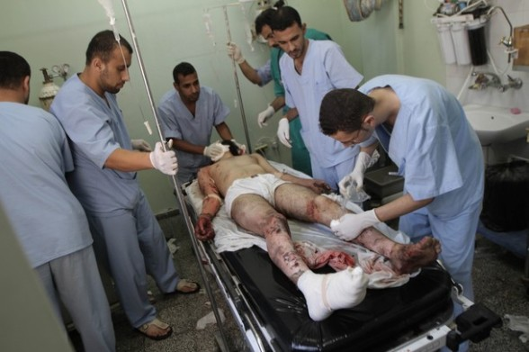 Palestinian medics tend to a wounded man at the al-Najar hospital following an Israeli air strike in Rafah in the southern Gaza Strip, on August 5, 2012. An Israeli air strike killed a Palestinian resistance fighter and wounded another as they rode a motorbike in southern Gaza, hospital officials said. AFP PHOTO/ SAID KHATIB