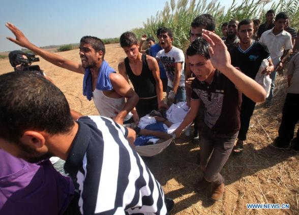 Palestinians carry a body killed in Israeli artillery shelling in the northern Gaza Strip on Sept. 6, 2012. Three Palestinians were killed Thursday morning in Israeli shelling in northern Gaza Strip, medical sources and witnesses said. The last bombing raised the number of Palestinians killed in Israeli strikes in the Gaza Strip to six in less than 12 hours. (Xinhua/Yasser Qudih)