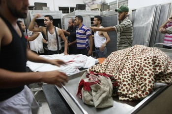 Palestinian mourners react as they gather around two bodies in the al-Najar hospital in Rafah, in the Gaza Strip on September 19, 2012. An Israeli air strike on the Gaza Strip killed two Palestinians and wounded one late on September 19, the Hamas-run emergency services said. AFP PHOTO / SAID KHATIB