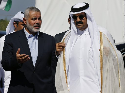 Hamas Prime Minister Ismail Haniyeh (L) and the Emir of Qatar Sheikh Hamad bin Khalifa al-Thani arrive at a cornerstone laying ceremony for Hamad, a new residential neighbourhood in Khan Younis in the southern Gaza Strip October 23, 2012. The Emir of Qatar embraced the Hamas leadership of Gaza on Tuesday with an official visit breaking the isolation of the militant Palestinian Islamist movement, to the dismay of Israel and rival, Western-backed Palestinian leaders in the West Bank. REUTERS/Mohammed Salem