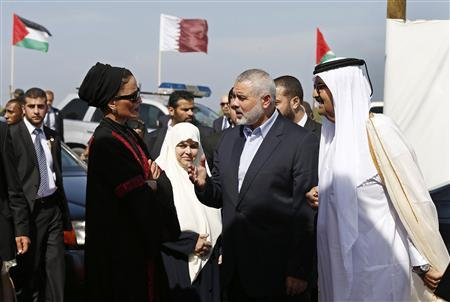 The Emir of Qatar Sheikh Hamad bin Khalifa al-Thani (R), his wife Sheikha Mozah bint Nasser al-Missned (L), Hamas Prime Minister Ismail Haniyeh (2nd R) and his wife Amal Haniyeh arrive at a cornerstone laying ceremony for Hamad, a new residential neighbourhood in Khan Younis in the southern Gaza Strip October 23, 2012. REUTERS/Mohammed Salem