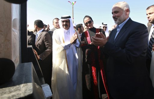 Hamas Prime Minister Ismail Haniyeh (R), the Emir of Qatar Sheikh Hamad bin Khalifa al-Thani (L) and his wife Sheikha Mozah bint Nasser al-Missned (C) attend a cornerstone laying ceremony for Hamad, a new residential neighbourhood in Khan Younis in the southern Gaza Strip October 23, 2012. The Emir of Qatar embraced the Hamas leadership of Gaza on Tuesday with an official visit breaking the isolation of the militant Palestinian Islamist movement, to the dismay of Israel and rival, Western-backed Palestinian leaders in the West Bank. REUTERS/Mohammed Salem