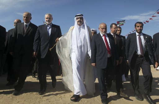 The Emir of Qatar Sheikh Hamad bin Khalifa al-Thani (C) and Hamas Prime Minister Ismail Haniyeh (3rd L) arrive at a cornerstone laying ceremony for a new center providing artificial limbs, in Beit Lahiya in the northern Gaza Strip October 23, 2012. The Emir of Qatar embraced the Hamas leadership of Gaza on Tuesday with an official visit breaking the isolation of the militant Palestinian Islamist movement, to the dismay of Israel and rival, Western-backed Palestinian leaders in the West Bank. REUTERS/Ali Ali/Pool