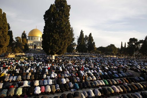 Palestinians pray in front of the Dome of the Rock on the compound known to Muslims as al-Haram al-Sharif and to Jews as Temple Mount in Jerusalem's Old city, on the first day of Eid al-Adha October 26, 2012. Muslims around the world celebrate Eid al-Adha to mark the end of the Haj by slaughtering sheep, goats, cows and camels to commemorate Prophet Abraham's willingness to sacrifice his son Ismail on God's command. REUTERS/Ammar Awad