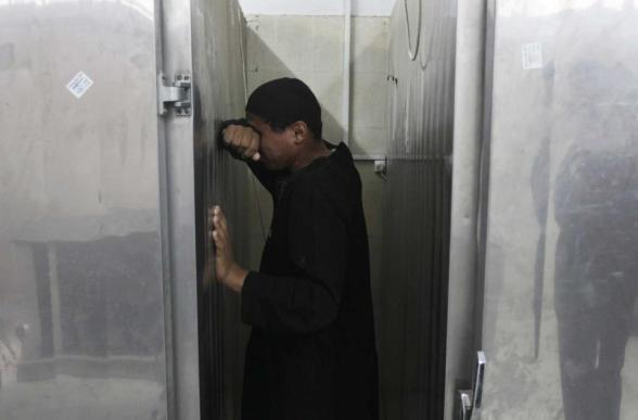 A Palestinian man reacts in front of a hospital morgue following an Israeli air strike in Rafah in the southern Gaza Strip October 24, 2012 . Israel killed one Hamas gunman in its second round of air strikes in as many days on the Gaza Strip on Wednesday, responding to rocket fire at its southern towns that wounded three people. Separate raids by Israel on Tuesday killed three Hamas gunmen on Tuesday, which the military said targeted squads preparing to launch rockets into the Jewish state. REUTERS/Ibraheem Abu Mustafa