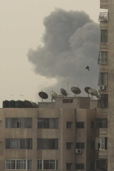 Smoke rises after an explosion in Gaza City October 24, 2012. Two explosions rocked Gaza City on Wednesday, witnesses said, shortly after Israel killed a gunman in the area citing an escalation of rocket fire at its southern towns and cities. REUTERS/Ahmed Zakot