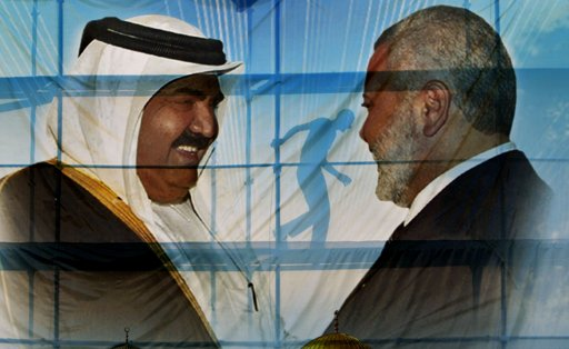 A Palestinian worker walks behind posters of the Emir of Qatar Sheikh Hamad bin Khalifa al-Thani, left, and Gaza's Hamas Prime Minister Ismail Haniyeh, right, in preparation for the upcoming visit to Gaza at Palestine stadium in Gaza City, Monday, Oct. 22, 2012. (AP Photo/Adel Hana)