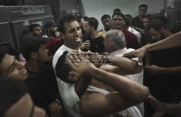 A Palestinian man reacts to the death of his relative in Kamal Edwan hospital morgue, northern Gaza
