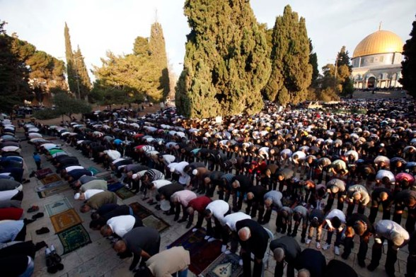 Oct 26, 2012 - Palestinians performing Eid prayers at al-Aqsa mosque (Photo by Afif Amira / WAFA)