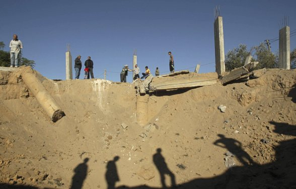 Palestinians inspect the damage to the construction site of a house after an Israeli air strike in Bureij refugee camp in the central Gaza Strip October 29, 2012. An Israeli army statement on Monday said the Israeli air force targeted three sites in the Gaza Strip in response to the incessant firing of rockets from Gaza into Israel. REUTERS/Ibraheem Abu Mustafa