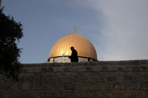 A Palestinian prays at the al-Aqsa Mosque compound in Jerusalem's Old City on the first day of Eid al-Adha. More than 50,000 Muslim worshippers have flooded the compound in Jerusalem's Old City for prayers on Friday, the first day of Eid al-Adha or Feast of Sacrifice, Israeli police said Photo by Ahmad Gharabli