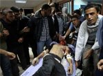A wounded man is taken into a hospital in Gaza City following