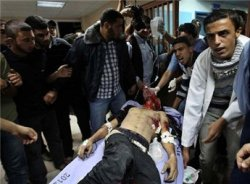 A wounded man is taken into a hospital in Gaza City following  Israeli shelling November 10, 2012. (Reuters/Mohammed Salem)