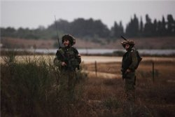 Israeli soldiers patrol near the border with the northern Gaza Strip on