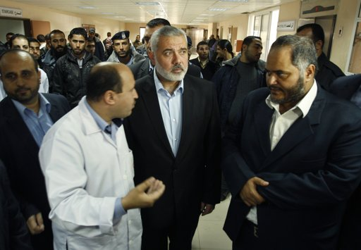 Hamas Prime Minister Ismail Haniyeh (C) arrives at Shifa Hospital in Gaza City, to visit Palestinians wounded in a recent surge of violence on the Israel-Gaza frontier, November 13, 2012. Israel and the Palestinians stepped back from the brink of a new war in the Gaza Strip on Tuesday, sending signals to each other via Egypt that they would hold their fire unless attacked, after five days of mounting violence. REUTERS/Ahmed Zakot
